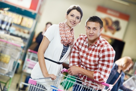supermarket trolley: Family at food shopping in supermarket Stock Photo