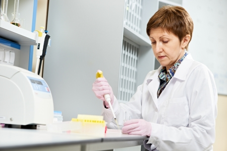 pharmaceutic: scientist with Dropper at laboratory Stock Photo
