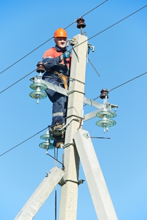 power electrician lineman at work on pole Stock Photo - 16220531