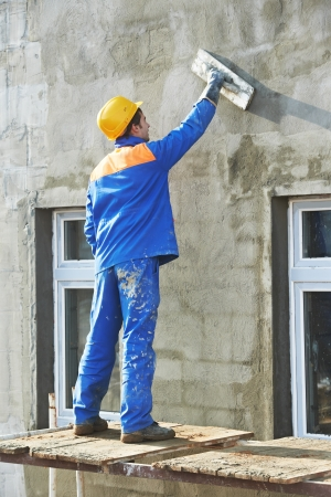 facade builder plasterer at work photo