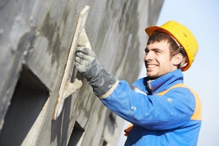 builder construction: facade builder plasterer at work Stock Photo