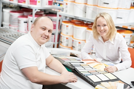 home improvement store: Seller and buyer selecting paint color Stock Photo