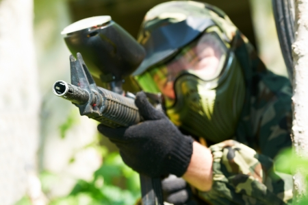 sports uniform: paintball player in summer  Shallow DOF Stock Photo