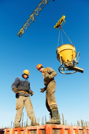 building workers pouring concrete with barrel Stock Photo - 16404874
