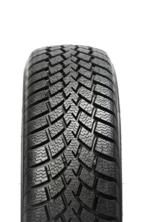 tyre tread: One automobile car wheel winter tyre isolated Stock Photo