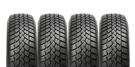 tread pattern: Stack of four car wheel winter tires isolated