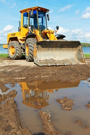 wheel loader excavator at work photo