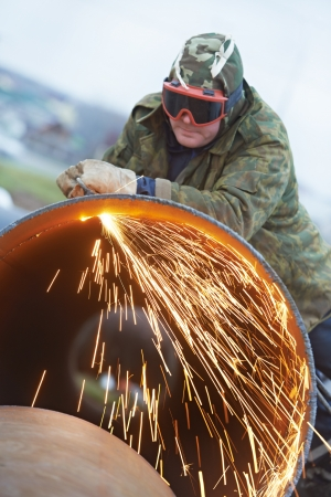 Welder worker with flame torch cutter photo