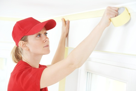 priming paint: Home Painter with masking tape
