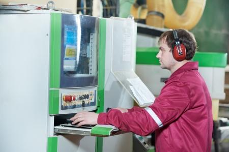 cnc machine: Portrait of carpentry worker with CNC machine