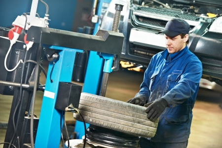 auto repairman at tyre replacement place Stock Photo - 17276471