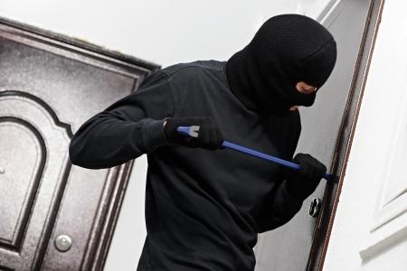 thief burglar at house breaking Stock Photo - 17276436