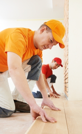 parquet workers at flooring work photo