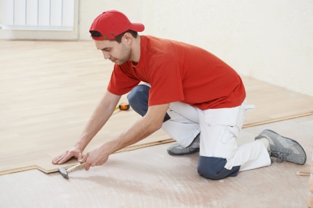 carpenter worker joining parket floor Stock Photo - 17276450