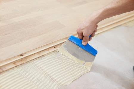 parquet floor layer: gluing parquet floor work Stock Photo