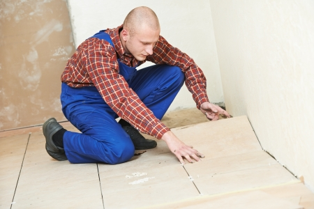 tiler at home floor tiling renovation work Stock Photo - 17276437