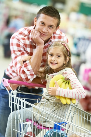 supermarket trolley: Family shopping in supermarket