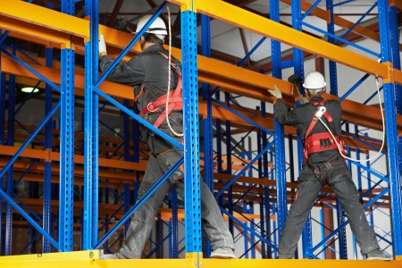 two warehouse workers installing rack arrangement photo