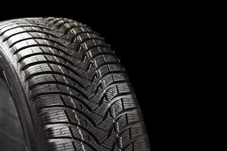winter tyre on black Stock Photo - 17271724