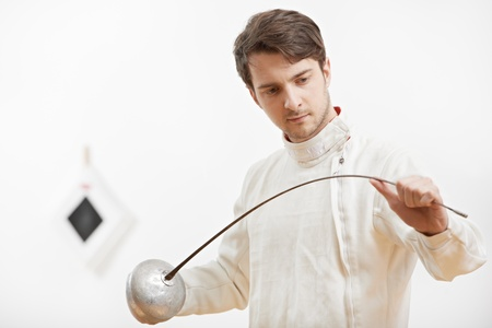 fencer checking rapier foil photo