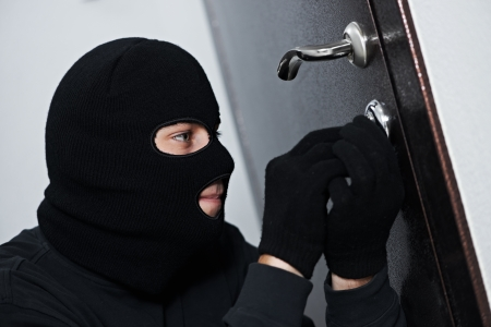 identity thieves: burglar thief at house breaking