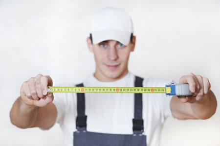 Handyman with measuring tape photo
