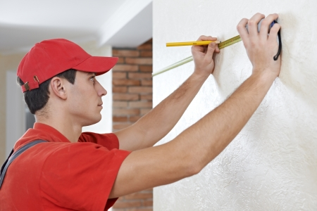 home inspection: Handyman with measuring tape Stock Photo