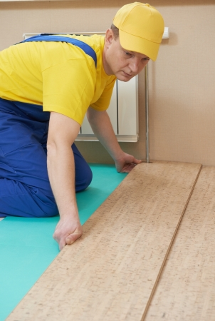 cork worker at flooring work Stock Photo - 17357722