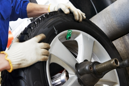 automobile workshop: close-up of wheel balancing Stock Photo