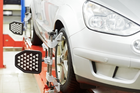 alignment: car at wheel alignment diagnostic tester Stock Photo
