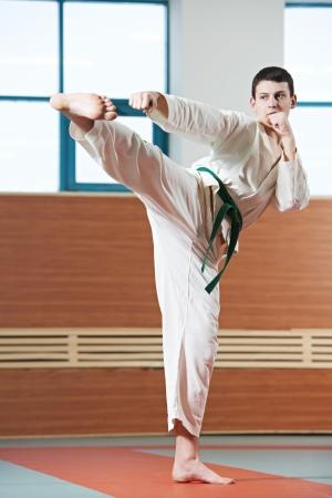 martial art: man at taekwondo exercises