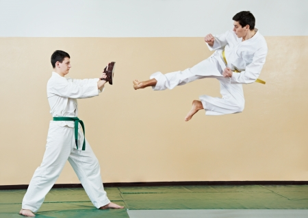 martial art: Two man at taekwondo exercises Stock Photo