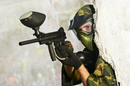paintball: paintball player under cover Stock Photo