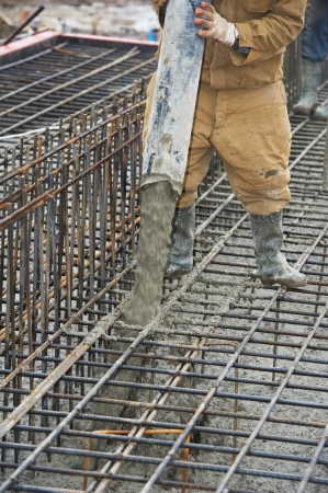 builder worker pouring concrete into form Stock Photo - 17448240