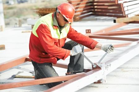 millwright: builder worker assembling metal construction Stock Photo
