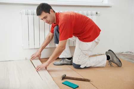 carpenter worker joining parket floor Stock Photo - 17411781