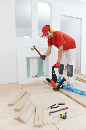 carpenter worker joining parket floor photo