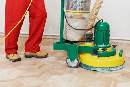 renewing: Parquet Floor maintenance by grinding machine Stock Photo