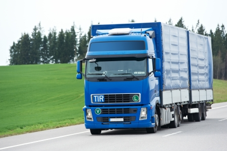 hauling: Blue lorry with trailer over blue sky Stock Photo