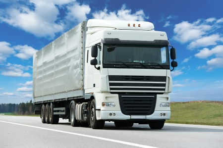 truck and trailer: White lorry with grey trailer over blue sky