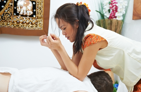 Traditional thai massage health care back kneading Stock Photo - 17411877