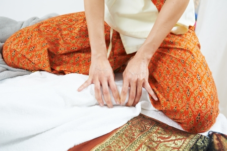 Traditional thai massage health care foot kneading Stock Photo - 17448230