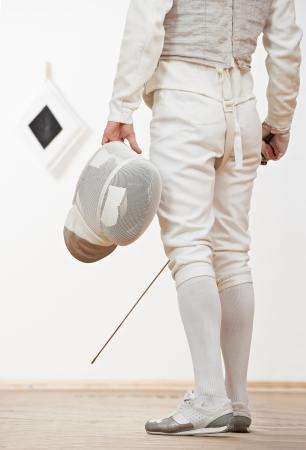 fencing foil: Fencer with mask rapier foil Stock Photo