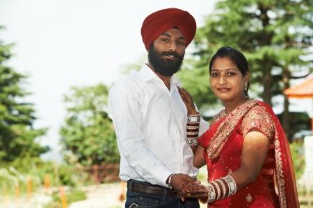 indian woman traditional: Happy indian young adult married couple Stock Photo
