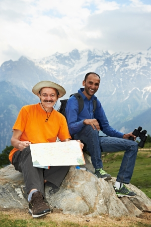 two smiling tourist hiker in india mountains photo
