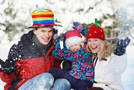 happy family with child in winter photo