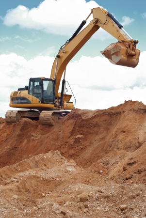 mining machinery: track-type loader excavator at work