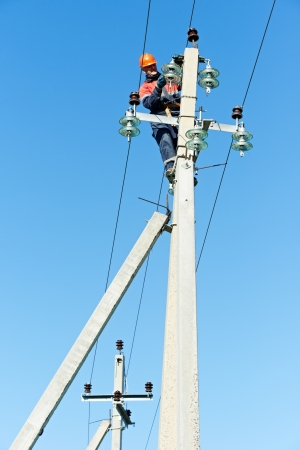 power electrician lineman at work on pole Stock Photo - 17641317