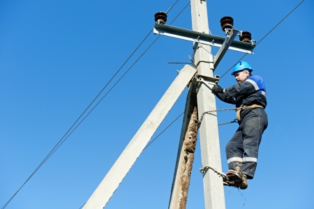 journeyman: power electrician lineman at work on pole