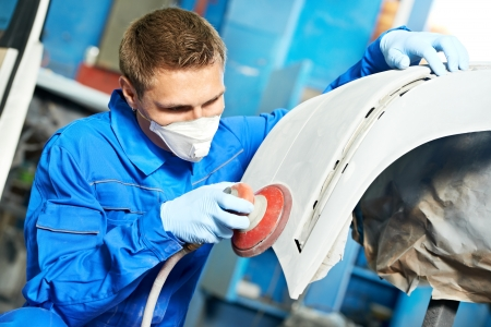 auto mechanic polishing car photo